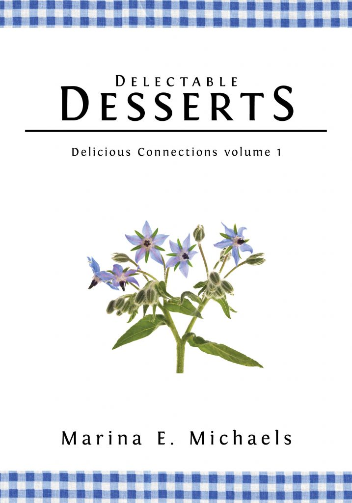 The cover of Delectable Desserts. Plain white cover with a blue gingham border at the top and bottom. Below the title is a spray of borage, which is a lovely periwinkle blue.